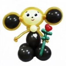 Черный Чебурашка с цветочком из воздушных шаров
